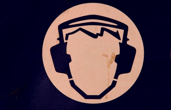 Why do DJs Wear Headphones While They are DJing?