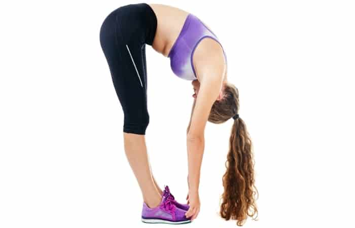 Stretch your neck, back, and legs with a slow forward fold, bending your body 90 degrees at the waist. Let your neck and head hang, feeling the stretch in the back of your legs while keeping the upper body relaxed. Stand up slowly.