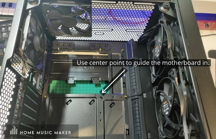 use center point to guide the motherboard in