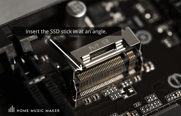 Insert the SSD stick in at an angle.