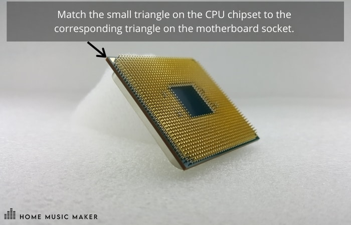 Match the small triangle on the CPU chipset to the  corresponding triangle on the motherboard socket.