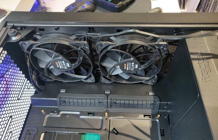 This is the perfect time to install cooling fans where you need them. Just be sure your setup stays balanced, so there's as much air being drawn in as it's being blown out. If you aren't sure which direction the wind will go, the fan guards usually indicate with an arrow which way the air flows.
