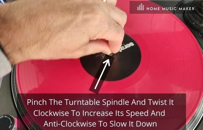Get in the mix - pinch the turntable spindle and twist it clockwise to increase its speed and anti-clockwise to slow it down.