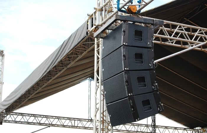 speaker stack - speakers face away from the performers on the stage,